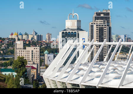 Kiev cityscape with the roof of Olympic stadium - Stock Photo