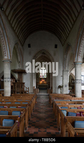 View down the nave to chancel, altar and east window inside the church at church of Saint Mary, Purton, Wiltshire, England, UK - Stock Photo