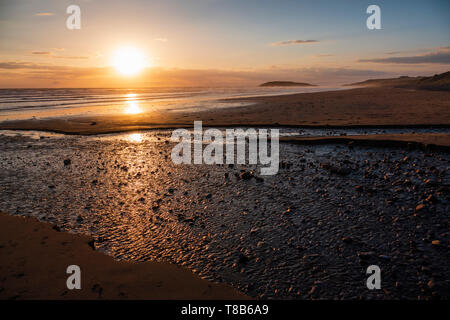 Sunset over a deserted Llangennith beach, Gower peninsula, Gower, Wales. - Stock Photo