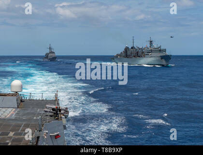 190508-N-SS350-0282 MEDITERRANEAN SEA (May 8, 2019) The Ticonderoga-class cruiser USS Leyte Gulf (CG 55) pulls alongside the fast combat support ship USNS Arctic (T-AOE 9) after the Arleigh Burke-class guided-missile destroyer USS Bainbridge (DDG 96) completed its replenishment-at-sea. Bainbridge is underway as part of the Abraham Lincoln Carrier Strike Group (ABECSG) deployment in support of maritime security cooperation efforts in the U.S. 5th, U.S. 6th and U.S. 7th Fleet areas of operation. With Abraham Lincoln as the flagship, deployed strike group assets include staffs, ships and aircraft - Stock Photo