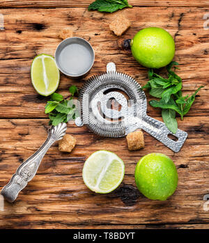 Make mojito cocktail with lime and mint - Stock Photo