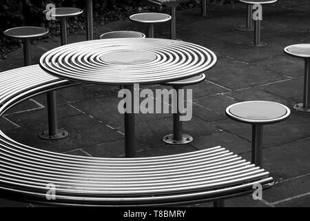Polished stainless steel outdoor furniture - Stock Photo