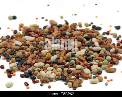 Mixed dried legumes isolated on white background, close up - Stock Photo