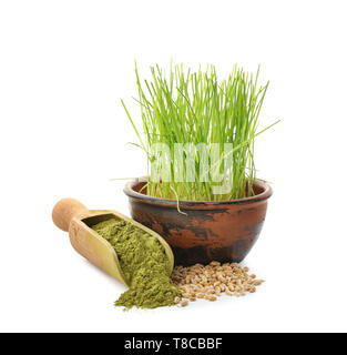 Fresh wheat grass with powder and seeds on white background - Stock Photo