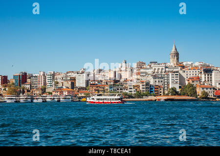 A tourist boat sails across the Golden Horn, Istanbul, Turkey - Stock Photo
