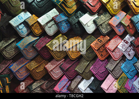 Colorful handbags at a store at the bazaar in Marrakesh, Morocco - Stock Photo