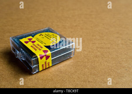 Small Cesium Radioactive in the Plastic package - Stock Photo