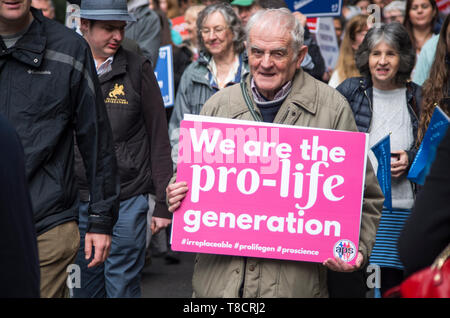 London, UK. 11 April 2019. Pro-life demonstrators take part in March for Life UK 2019 through Westminster, London.  This year's theme is 'irreplaceable' – every single human being, right from the first moment of his or her conception is unique,  he/she cannot be replaced by any other human being. © Stuart Walden/ Alamy - Stock Photo