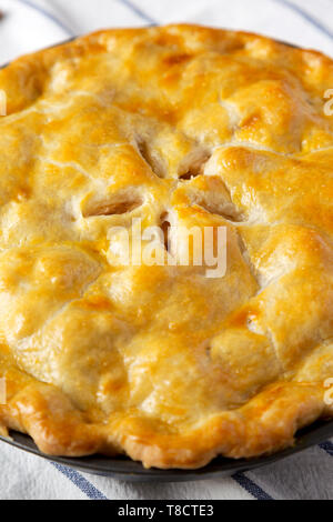 Homemade apple pie on cloth, close-up. - Stock Photo