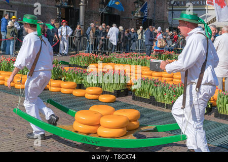 Alkmaar, the Netherlands - April 12, 2019: Traditional cheese market on the Waagplein square in Alkmaar. - Stock Photo