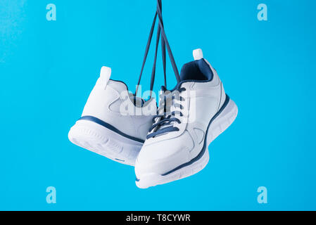 Fashion male sport shoes on blue background. Stylish man sneakers for fitness, close up - Stock Photo
