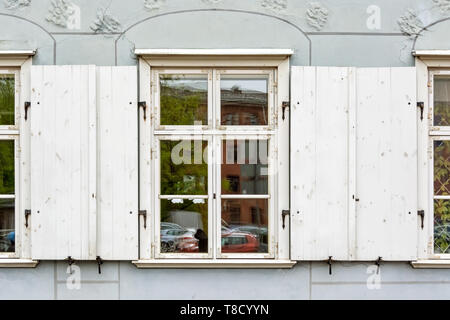 Rectangular window with open white wooden shutters in old Riga. - Stock Photo