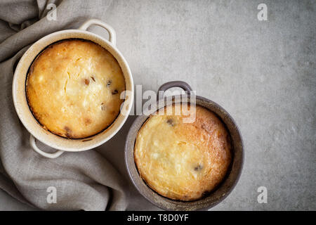 Two pans with cottage cheese casserole on gray table. Top view - Stock Photo
