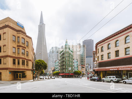 Central San Francisco with famous Transamerica Pyramid and historic Sentinel Building at Columbus Avenue on a cloudy day