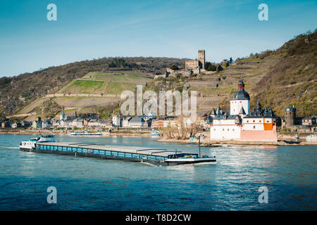 Beautiful view of the historic town of Kaub with famous Burg Pfalzgrafenstein along Rhine river on a scenic sunny day with blue sky in spring, Rheinla - Stock Photo