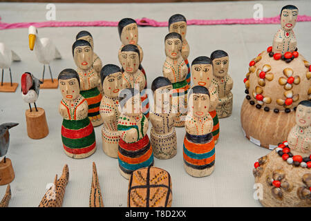 Boca de valeria, Brazil - December 03, 2015: souvenirs of wooden figurines, birds and animals on white tablecloth background. Presents and gifts. Travel and tourism concept. - Stock Photo