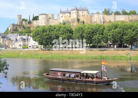 France, Indre et Loire, Loire Valley listed as World Heritage by UNESCO, Chinon, traditional Ligerien boat trip (toue cabanee) on the Vienne river at the foot of the castle - Stock Photo