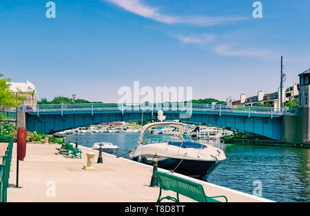 Michigan City, Indiana / USA on July 28th 2018: Boats docked at Millennium Plaza which sits along Trail Creek at the entrance to Heisman Harbor on a   - Stock Photo