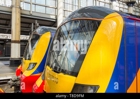 A Siemens South Western Railway Desiro City Class 707 train in its distinctive livery at London Waterloo, UK - Stock Photo