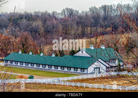 A horse ranch/horse farm/stable with a white wooden fence in Michigan, USA. - Stock Photo