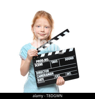 Cute little girl with clapper board on white background - Stock Photo