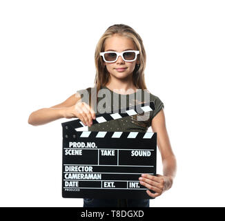 Cute little girl with clapper board wearing 3D cinema glasses on white background - Stock Photo