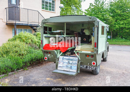 Vintage ambulance outside the Science & Innovation Centre at Bletchley Park, top-secret home of the World War Two Codebreakers, now a heritage museum - Stock Photo