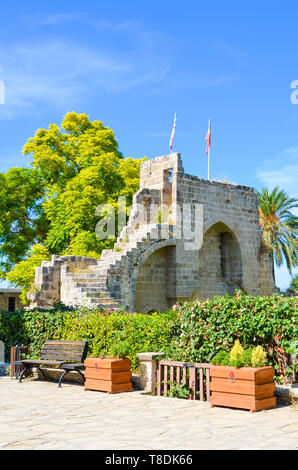 Amazing Bellapais Abbey in small Cypriot city Bellapais captured on a vertical picture with green trees around. - Stock Photo