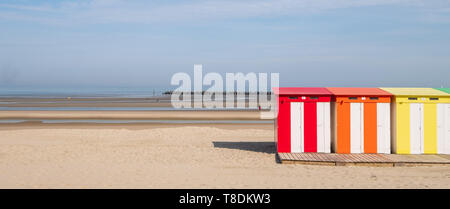 Dunkerque, France: Candy coloured striped beach huts on the sea front at Malo-Les-Bains beach in Dunkirk. - Stock Photo