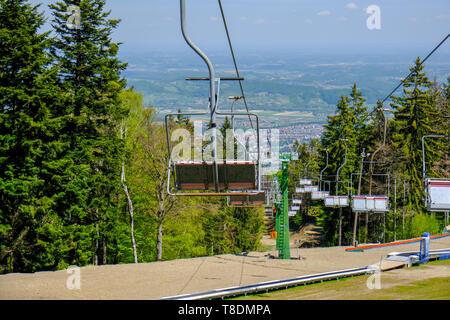 Empty ski lift in the summer, preparation for winter skiing season, ski slopes outside winter season - Stock Photo