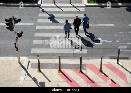 High Angle View of Three People or Pedestrians Crossing Pedestrian Crossing or Zebra Marseille France - Stock Photo
