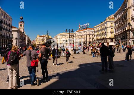 Street Life scene, Puerta del Sol square. Since 1950 called Kilometre Zero of the Spanish radial roads. Madrid city, Spain. Europe. Madrid city, Spain - Stock Photo