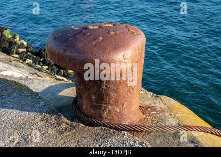 Mooring Bollard for Securing Large Ships and Boats Situated on the Brixham Breakwater,Torbay,Devon.England - Stock Photo