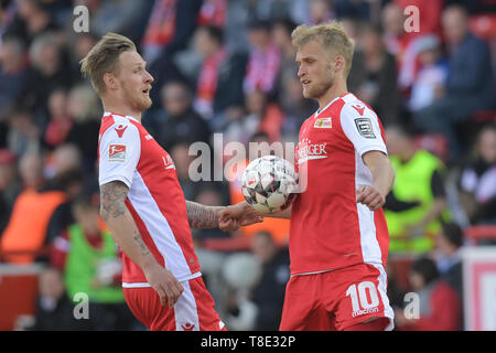 Berlin, Germany. 12th May, 2019. Soccer: 2nd Bundesliga, 1st FC Union Berlin - 1st FC Magdeburg, 33rd matchday. Unions Sebastian Polter (l) and Sebastian Andersson get close. Credit: Jörg Carstensen/dpa - IMPORTANT NOTE: In accordance with the requirements of the DFL Deutsche Fußball Liga or the DFB Deutscher Fußball-Bund, it is prohibited to use or have used photographs taken in the stadium and/or the match in the form of sequence images and/or video-like photo sequences./dpa/Alamy Live News - Stock Photo