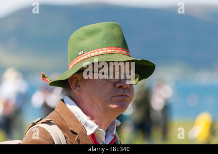 Gourock, Scotland, UK. 12th May, 2019. A spectator during the 63rd annual Gourock Highland Games which celebrates traditional Scottish culture with pipe band competitions, highland dancing, traditional highland games and is held in the picturesque setting of Battery Park.  Credit: Skully/Alamy Live News - Stock Photo