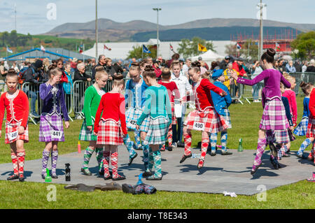 Gourock, Scotland, UK. 12th May, 2019. Highland dancers in the 63rd annual Gourock Highland Games which celebrates traditional Scottish culture with pipe band competitions, highland dancing, traditional highland games and is held in the picturesque setting of Battery Park.  Credit: Skully/Alamy Live News - Stock Photo
