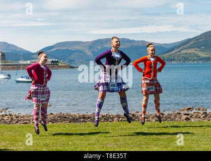 Gourock, Scotland, UK. 12th May, 2019. Highland dancers performing at the 63rd annual Gourock Highland Games which celebrates traditional Scottish culture with pipe band competitions, highland dancing, traditional highland games and is held in the picturesque setting of Battery Park.  Credit: Skully/Alamy Live News - Stock Photo