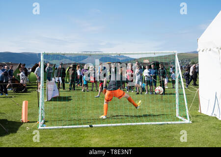Gourock, Scotland, UK. 12th May, 2019. A beat the goalie competition at the 63rd annual Gourock Highland Games which celebrates traditional Scottish culture with pipe band competitions, highland dancing, traditional highland games and is held in the picturesque setting of Battery Park.  Credit: Skully/Alamy Live News - Stock Photo
