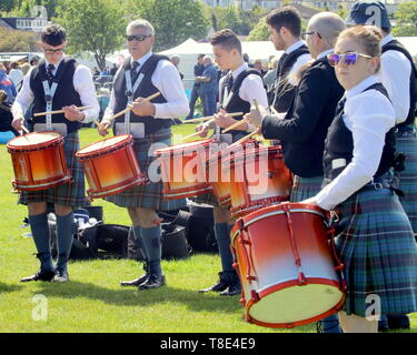 Gourock, Scotland, UK, 12th May, 2019, UK Weather. Sunny scorcher of a day for the first Highland games of the year as people enjoy the sun in plaid. Credit Gerard Ferry/Alamy Live News - Stock Photo