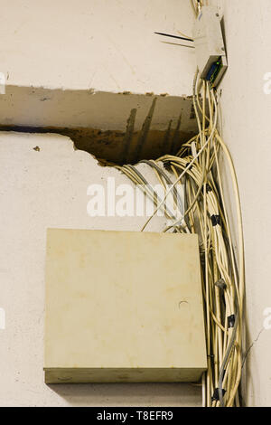 tangled network cables and wires in server room - Stock Photo