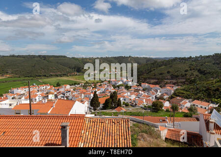 View over the red tiled roofs of Odeceixe at the Algarve, Portugal. - Stock Photo