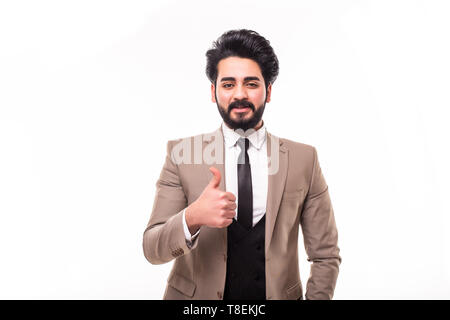 Arab handsome young businessman with hand in pocket smiling and thumbs up on white background - Stock Photo