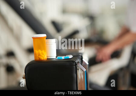 Plastic bottles with tablets. Bottle with medication on blurred fitness gym background. Nutrition supplement, body care. - Stock Photo