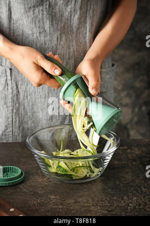 Woman making zucchini spaghetti, closeup - Stock Photo