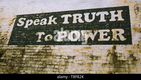 Painted sign on wall in Culpeper Virginia 'Speak Truth to Power' - Stock Photo