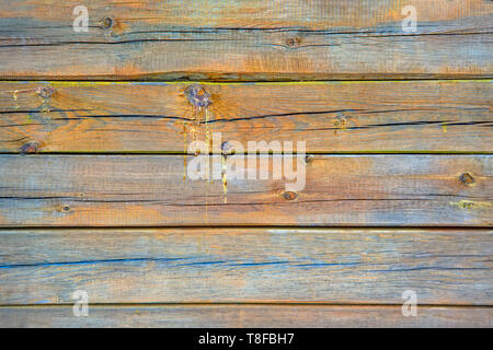 Texture of old wooden boards covered with cracks and drips of resin. Natural background. - Stock Photo