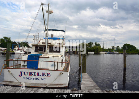 A pleasure boat anchored in Pembroke Creek off of the town of Edenton in North Carolina's Inner Banks. - Stock Photo