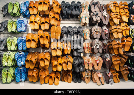 Key West, USA-december 26. 2015 : Rubber sandals on shop display , shopping . Assortment of male and female shoes of different colors. Pool or beach slides. Summer vacation concept. Recreation - Stock Photo