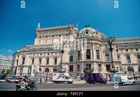 France, Paris, cars traveling on quai next to River Seine at