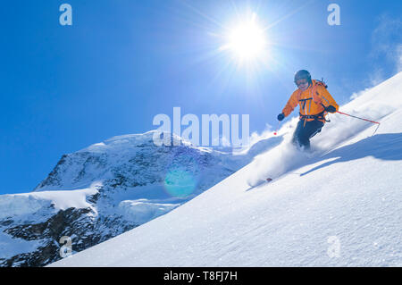 Expert skier on Monte Rosa glaciers in impressive high alpine nature - Stock Photo
